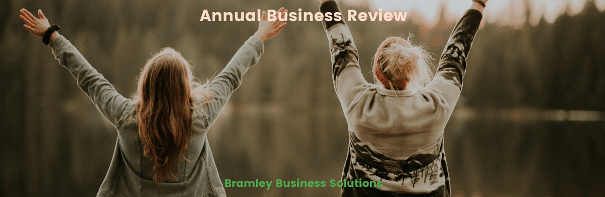 two women celebrating completing their annual business review outdoors