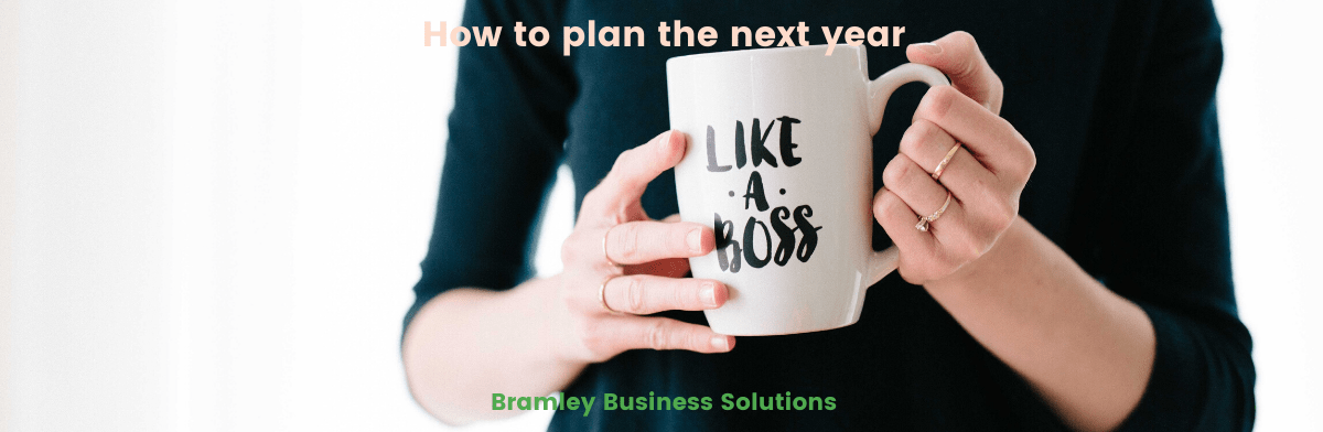 woman holding a mug with the words 'like a boss', title of the article across the top of the image 'how to plan the next year'