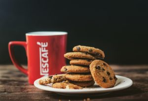 Batching - a batch of biscuits with a cup of coffee