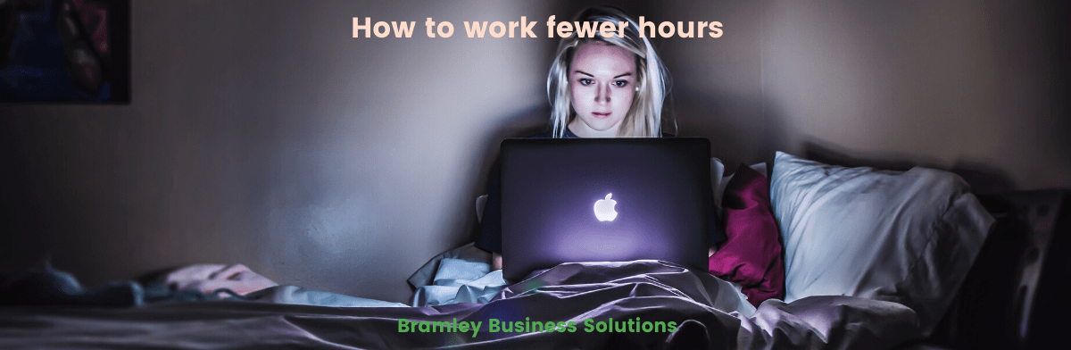 "banner image for blog ""how to work fewer hours"" by Bramley Business Solutions, showing a woman sitting in the dark working on a laptop"