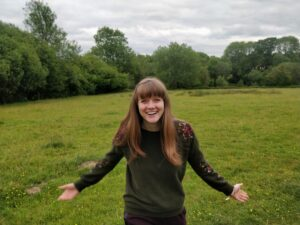 Emma Langridge standing in the beautiful Kent countryside, providing small business support in Kent