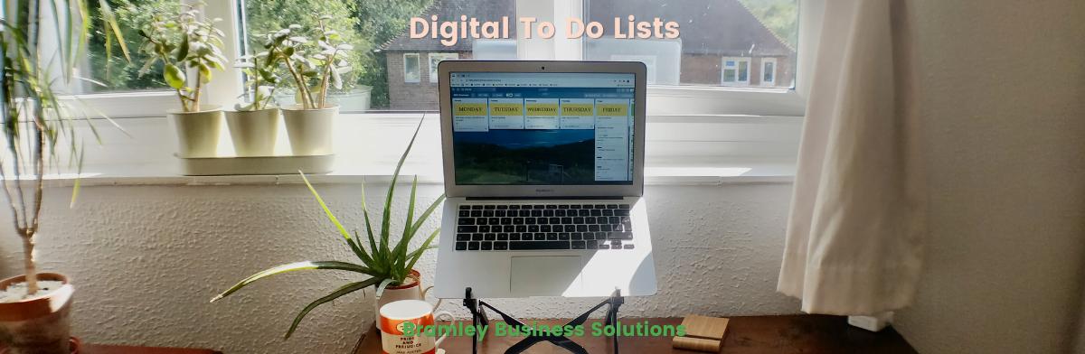 Laptop open on desk showing a digital to do list