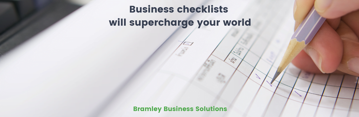 picture of a business checklist in use, with blog title 'business checklists will supercharge your world' over the top